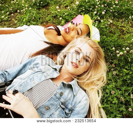 Two Pretty School Girls On Grass Happy Smiling, Best Friends Having Fun Together, Lifestyle People C