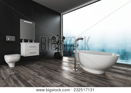 Large modern bathroom with bidet, vanity and boat-shaped tub on a wooden parquet floor overlooking a misty winter landscape through a glass wall. 3d rendering