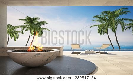 Burning fire feature in a bowl on a luxury tropical deck with palm trees overlooking the ocean. 3d Rendering