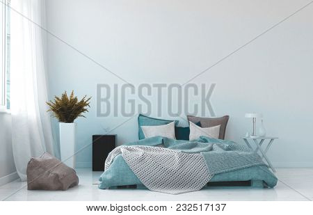 Cool blue and white bedroom interior with a rumpled queen-sized bed unmatched bedside tables and potted plant in front of a large bright window with drapes. 3d rendering