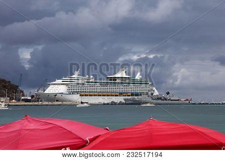 PHILIPSBURG, ST.MAARTEN - AUGUST 2: Royal Caribbean cruise ship Adventure Off The Seas is docking near  Great Bay walkway in Philipsburg, seen in St.Maarten on August 2, 2015