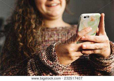 Teenage girl using a smartphone on a bed social media and addiction concept