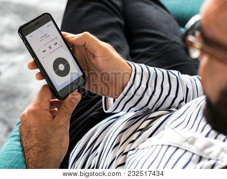 Closeup of a man streaming music