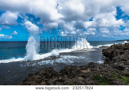 Geysers Shoot Toward The Sky As The Ocean Tide Rolls In And Forces Water Through Blowholes.