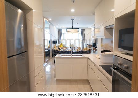 Modern Kitchen Set With Appliances In Studio Flat With Combined Dining Area And Living Space. Corner