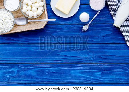 Natural Farm Products. Milk, Cottage, Eggs, Cheese, Yougurt On Blue Wooden Background Top View Copy