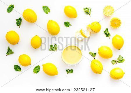 Lemon Curd In Bowl Among Lemons On White Background Top View.