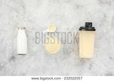 Sport Nutrition Set With Protein Powder For Cocktail And Scoop On Gray Stone Background Top View Spa
