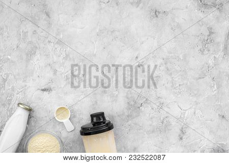 Nutrition For Workout With Protein Cocktail, Powder And Milk On Stone Table Background Top View Mock