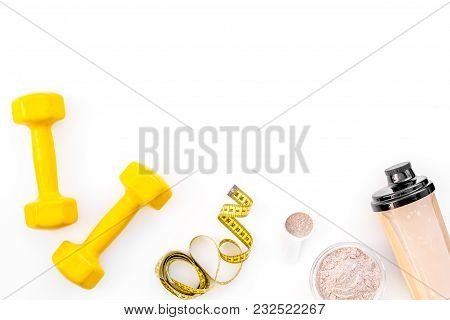 Nutrition For Workout With Protein Cocktail, Powder And Bars On White Table Background Top View Mock