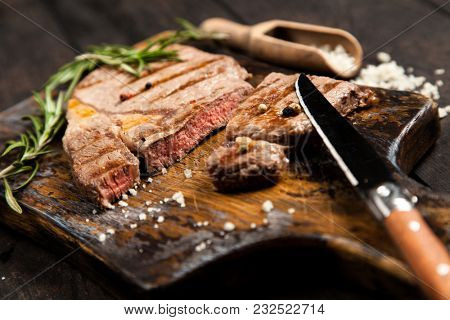 Grilled steak on wooden cutting board