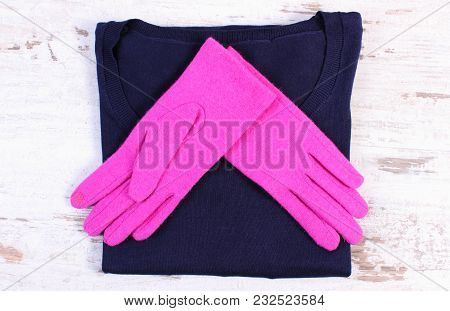 Pair Of Pink Gloves And Navy Blue Sweater For Woman On Old Rustic Board, Womanly Accessories, Warm C