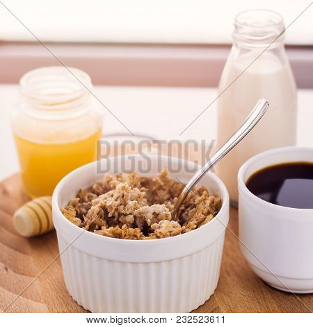 Healthy Breakfast Fresh Cereal, Milk Bottle, Coffee Cup And Honey Jar, Toned Warm Sunny Morning Ligh