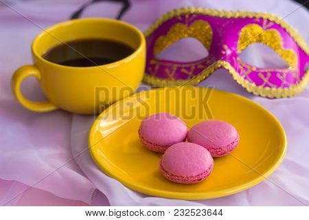 Pink Macaroons On A Yellow Plate,yellow Coffee Mug And Pink Mask