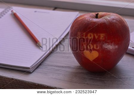 Fresh Red Apple Whit I Love You Sign Whit A Pen And Open Notebook At Wooden Background