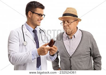 Doctor recommending pills to a mature man isolated on white background