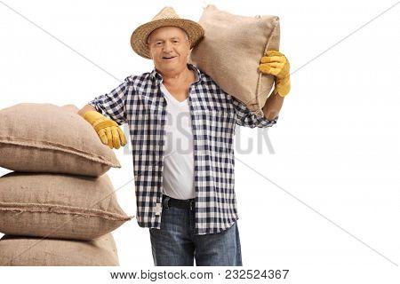Elderly farmer with burlap sacks isolated on white background