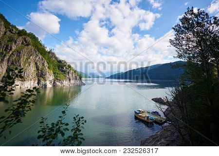 Lake Vidraru, Romanian Lacul Vidraru, Is An Artificial Lake In Romania In Fagaras Mountains. Blue Sk