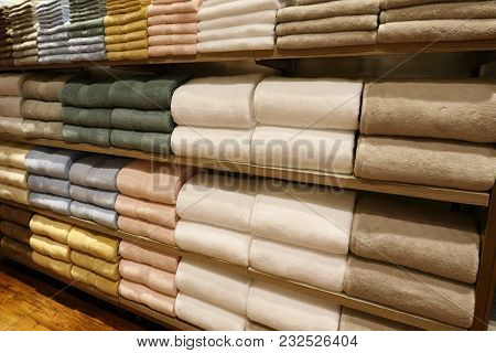 Image Of Piles Of Towels On The Shelves