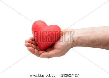 Red heart in man's hand