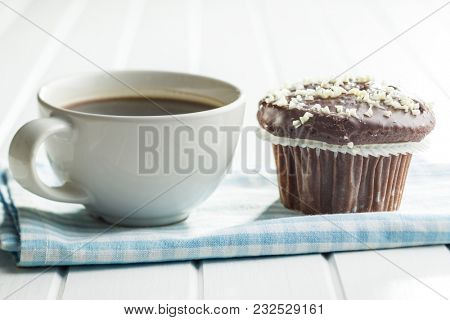 Tasty chocolate muffins. Cupcakes and coffee cup.