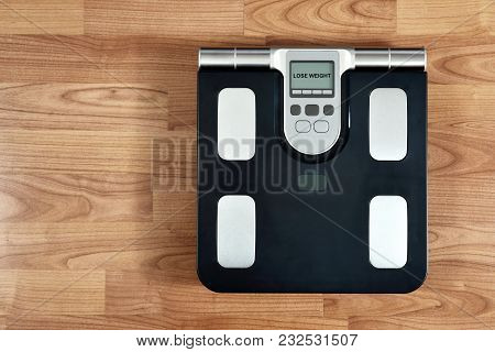 Scale On Wooden Background Top View.lose Weight Theme.