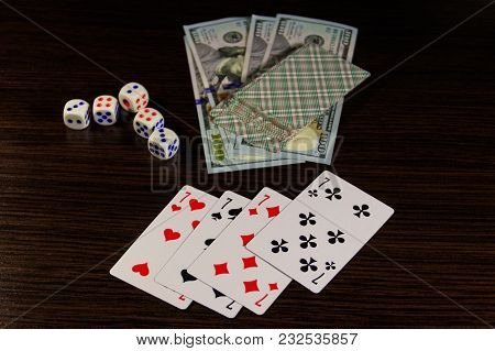 Playing Cards, Dice And Dollars On A Table