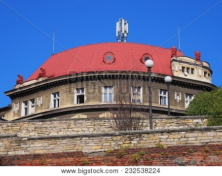 Round Historical Building With Red Roof And Walls In City Center Of Bielsko-biala In Poland With Cle