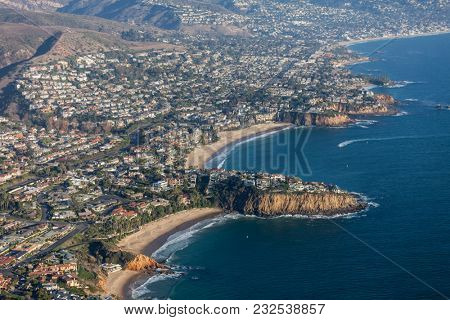 Aerial view of pacific ocean coves in Laguna Beach, California.