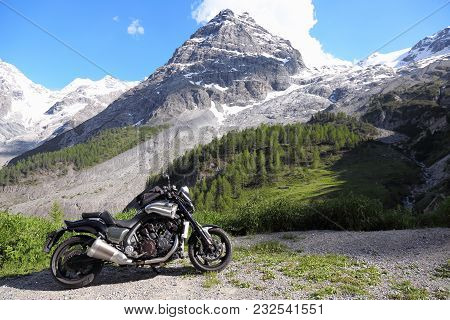 Stelvio Pass, Italy - June 24, 2016: Beautiful Motorcycle Parked At The Road To Stelvio Mountain Pas
