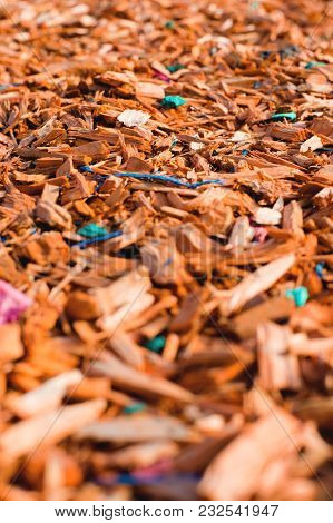 Textured Background Decorative Colored Sawdust For Finishing Flowerbeds In The Winter Season In Outl