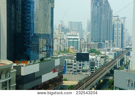 Cityscape Of Modern Office Building & Railway Of Bts Sky Train Mass Transit System In Asoke-sukhumvi