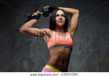 Athletic Woman With Long Black Hair In Colorful Sportswear Holding One Dumbbell.