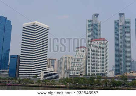 Cityscape Of Modern Office Building On Ratchadapisek Road Opposite Of Benjakiti Park In Bangkok, Tha