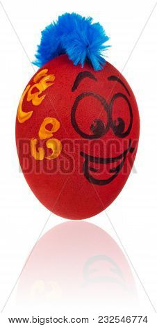 Easter Egg, Painted In Smiling Cartoon Face Of Guy. Decorated Egg With Funny Colorful Hairstyle And