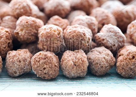 Border Of Chocolate Corn Balls Dry Breakfast On Blue Wooden Background
