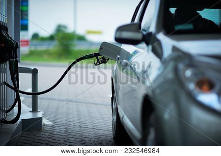Car Refueling On A Petrol Station. Front View.