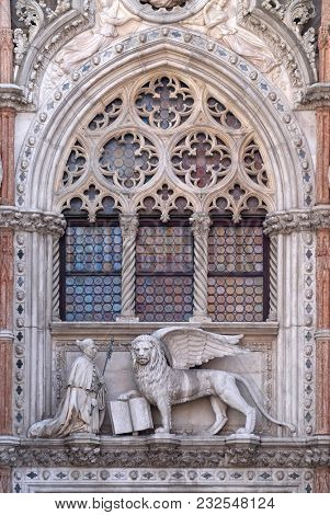 VENICE, ITALY - MAY 28, 2017 : Detail of the Porta della Carta, Doge's Palace in Venice, Italy, depicting Doge Francesco Foscari kneeling before the Lion of St. Mark, UNESCO World Heritage Sites