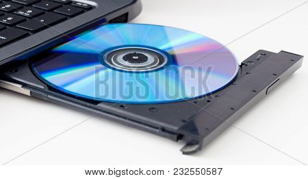 Laptop With Open Dvd Tray Isolated On A White Background