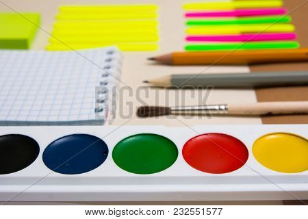 Watercolors And School Supplies For Primary School