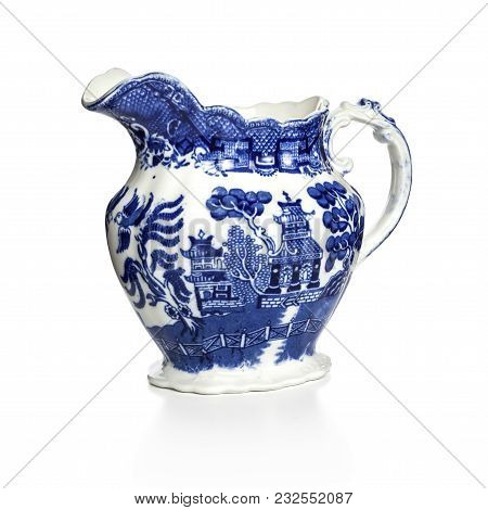 Blue Willow Pattern Jug On White Background With Soft Shadow At Base. Made In England In The 1930s B