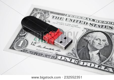 One Dollar And Usb Memory Isolated On A White Background