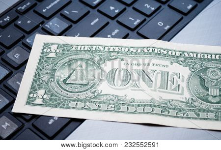 One Dollar On The Black Computer Keyboard