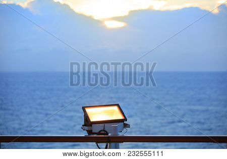 Flood light focused to the sky on boat