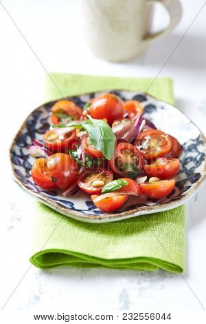 Tomato salad with pine nuts and capers