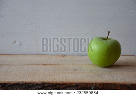 Fresh Green Apple On A Wooden Table.