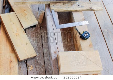 Construction Of A Wooden Frame House - Tape Measure, Gon, Tools, Cutting And Measuring Of Boards.