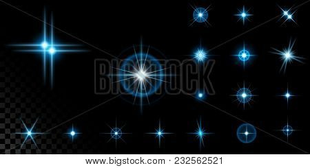 Big Set Of The Realistic Sparkling Blue Star Fires And Flashes On A Black Transparent Background. A