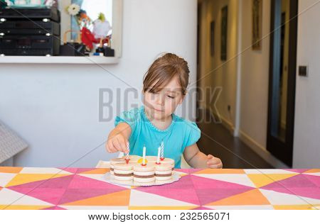 Little Child Putting Candles On Party Cake