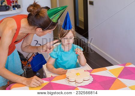 Woman Scolding Little Child At Party